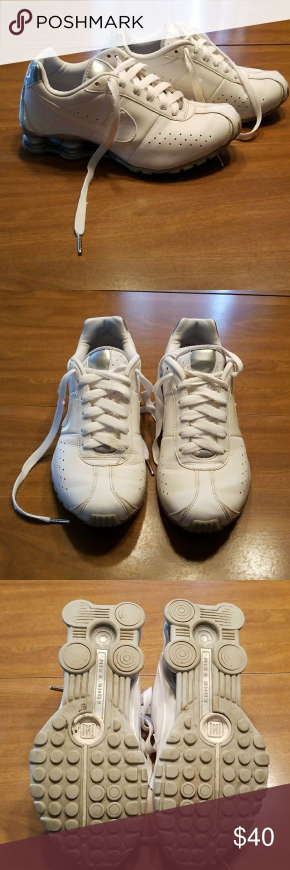 White and silver Nike shox White and silver Nike shox classic, average amount of wear, but still have a lot of life left, have been cleaned and ready to ship Nike Shoes Sneakers