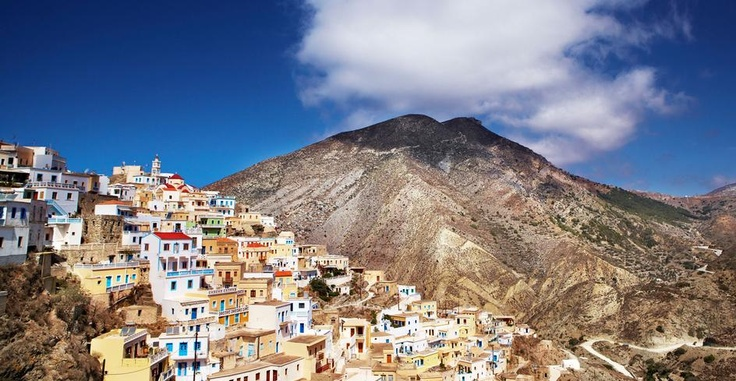 Karpathos Island-hop across the Aegean, from the natural wonders of Karpathos to the holy sites of Patmos. The village of Olympos sits high on a hill on Karpathos.