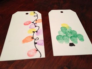 Finger Print Gift Tags: Cut card stock & punch a hole in it (or buy plain white gift tags at craft store). Then have the kids use their fingerprints to make these fun designs. (15 Holiday Crafts for Kids) #Christmas