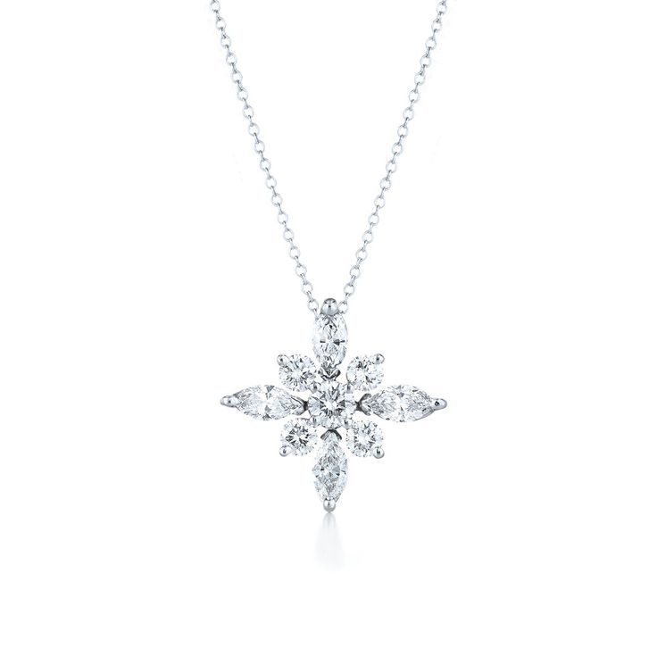 Small diamond pendant from the Kwiat Star Collection in platinum A flash of light, a brilliant star, timeless fashion; the elegantly simple design combines the brilliance of round and marquise diamonds. The chain is 16 inches in length. Price: $2,650