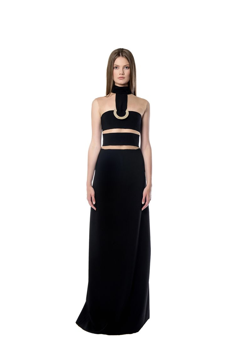 Black maxi dress with cut - outs  Black maxi dress with cut-out strips of fabric in the top, also making a cool form with its gold detail held on the bottom of the neckline. All made of crepe