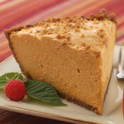 Gingersnap Pumpkin Chiffon Pie | Meals.com - A sweet gingersnap crust filled with a delicious pumpkin chiffon filling will have your fam fighting for the last slice! Add this perfect holiday pie to your roster this year. #fallbaking #pumpkinpie #thanksgiving