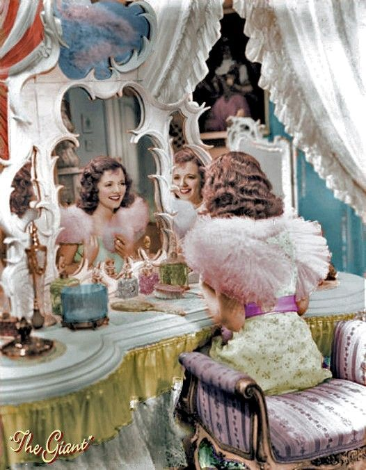 Old Hollywood movies are filled with images like this, of a glamorous starlet primping for an evening out in front of a stunning vanity table. A vanity table suggests intimacy and romance to a room.