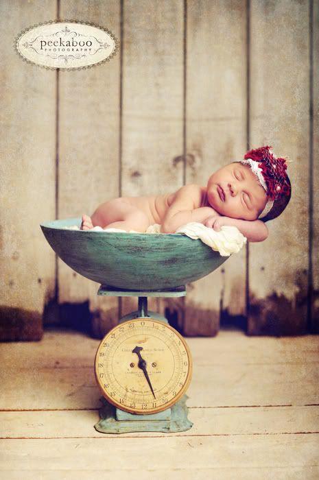 Newborn on vintage weighing scale