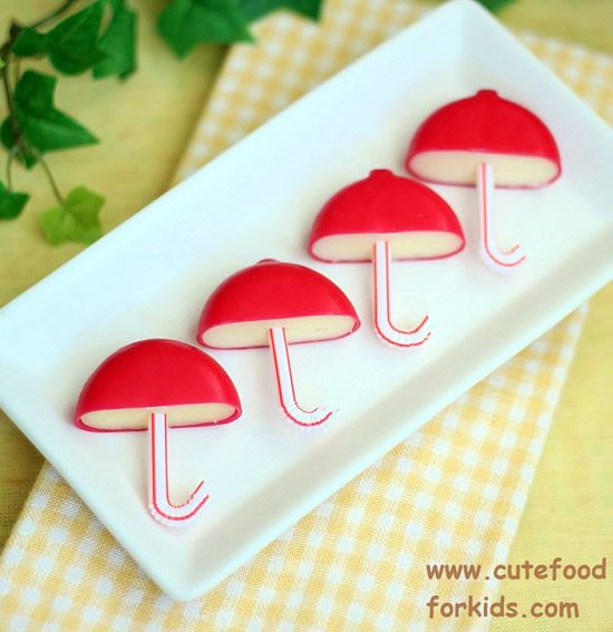 Babybel Umbrellas - Cute idea for spring party, kids party or baby shower!  Could even use pretzel sticks instead of straws and turn them into little mushrooms!
