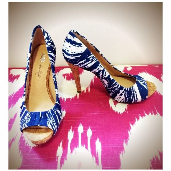 Hot abstract print peep toe platforms! Hot hot hot! Dark blue and white abstract print. Genuine cork platform and feel. Genuine leather outsole. Perfect Pin Up Look! Brand new! Never been worn! True size 6 but runs slightly narrow. Shoes