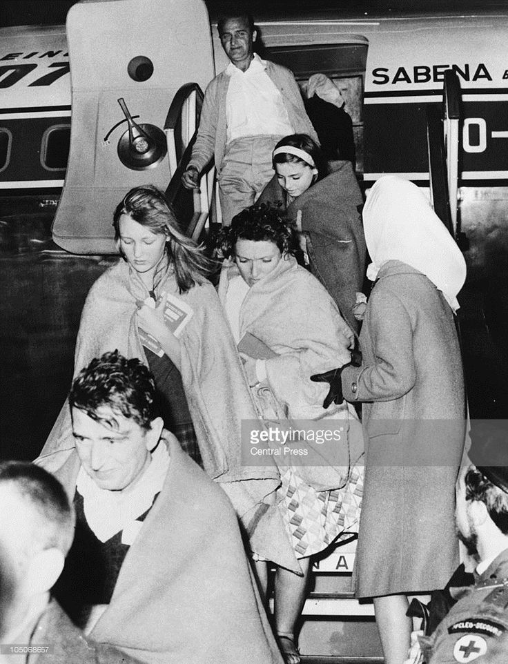 Former hostages arrive in Brussels after being rescued in 'Operation Dragon Rouge', a US-Belgian operation to rescue hostages held by Congolese Simba rebels in Stanleyville (now Kisangani) in the Republic of the Congo (Leopoldville), during the Congo Crisis, 26th November 1964.