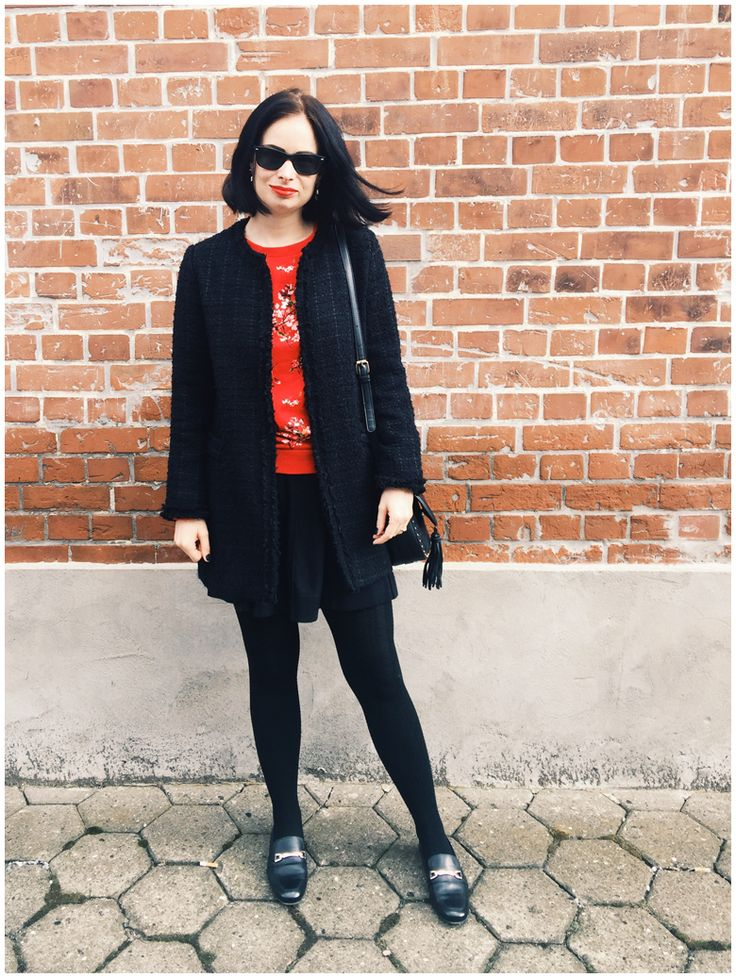 ROUGE & NOIR | June Gold wearing a black Zara coat and a red h&m sweater with cherry blossom print
