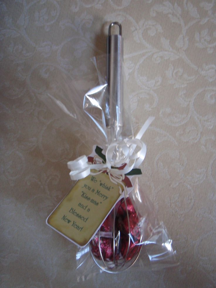 DIY Christmas Treats or use at each place setting. WHISK You a Merry Kissmass.  Just a dollar store whisk filled with Hershey Kisses.  The tag is super cute!