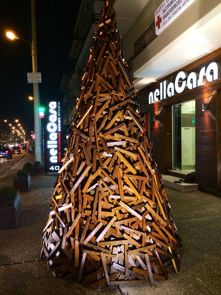 A Christmas tree I've made for my store by my own!it is 3,3 meters tall and it's made from iroko wood!