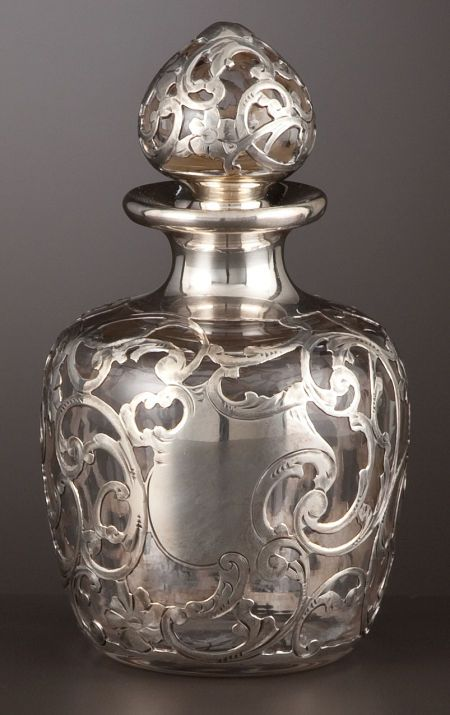 AN AMERICAN PERFUME BOTTLE WITH SILVER OVERLAY . Gorham Manufacturing Co., Providence, Rhode Island, circa 1900.