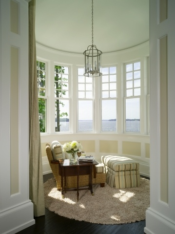 built-in bedroom sitting & reading niche / nook / alcove. arch, curtains, windows