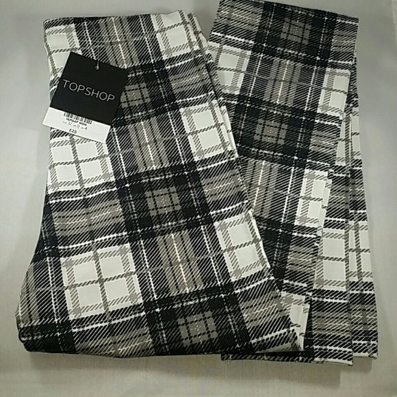 SALE! Plaid Topshop Leggings Brand new with tags. Topshop Leggins. Black and white plaid. They are a size 0, but they are very tiny! Topshop Pants Leggings