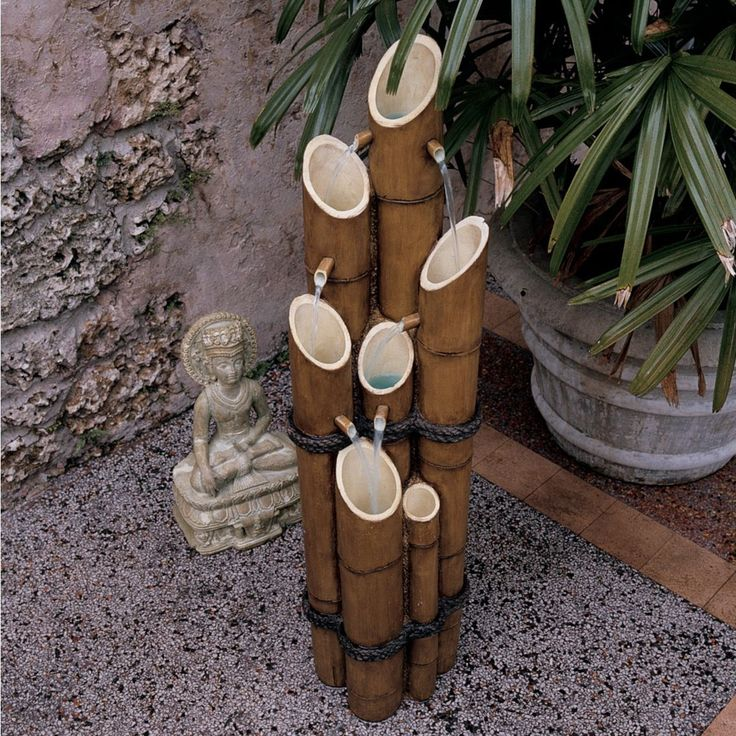 Features:  -Sculptural fountain.  -Hand painted.  -Design Toscano exclusive.  -Quality designer resin construction.  Finish: -Brown.  Material: -Resin/Bamboo.  Style: -Contemporary.  Fountain Design: