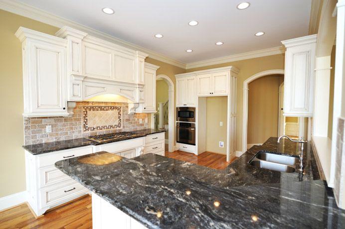 granite countertop with white cabinets