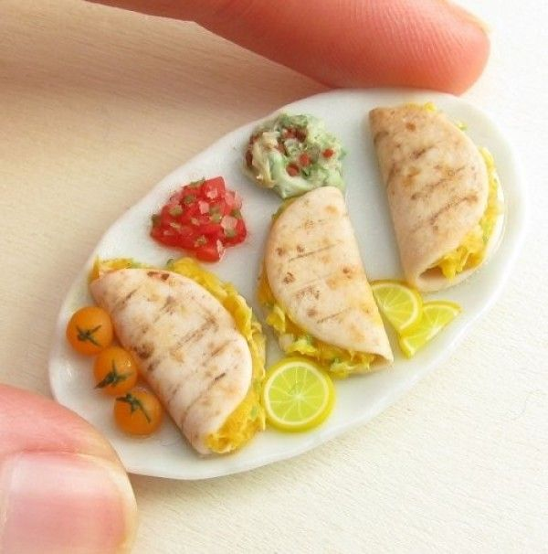 Tiny little food made from polymer clay!  I used to do this as a kid...make food out of clay all the time!  I look forward to when my daughter is older and we can do it together. :)