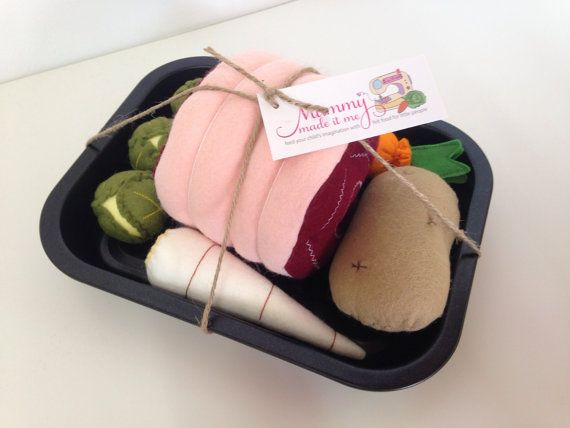 The perfect gift for your little Chef!  Every child loves to play with pretend food and this Roast Dinner Set is perfect for making dinner just like mummy or daddy does.  Includes: 1 x Roast joint of meat. 1 x Carrot 1 x Parsnip 1 x Large Potato 3 x Brussel Sprouts 1 x Roasting Tin  The Roasting Tin measures approximately 25cm x 19cm and is a real Roasting tin, not made out of felt!  Most of these items have been largely machine stitched for neatness and durability although each item does…