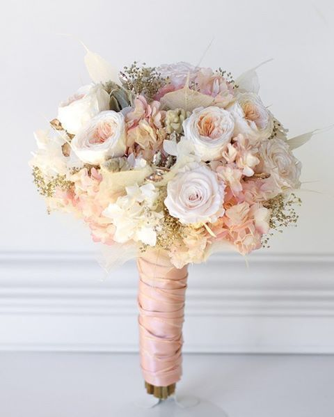Rose gold wedding bouquet All preserved real flowers to last for years. Cotton candy pink hydrangea, blush white roses, pink and cream garden roses, angel leaves, rose gold gems, gold babies breath, and touch of soft gray lambs ear.