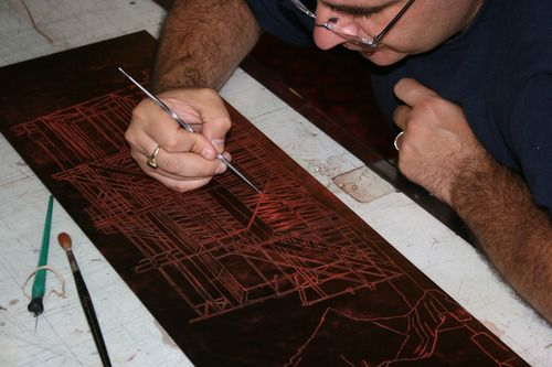 Steve Lopes working on an etching plate in the Duck Print Fine Art workshop