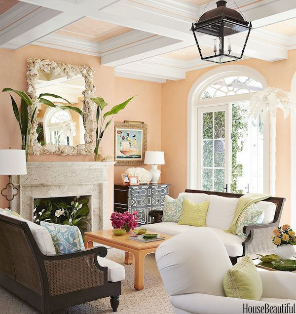A British-Colonial Take on Palm Beach Style by Kemble Interiors in House Beautiful <3 Like a tempting cocktail, the living room is swathed in a delicious cantaloupe color that serves as a wonderful backdrop for a frothy mix of British colonial & contemporary pieces with a Palm Beach twist. The shots of black keep it anchored as the eye is drawn to the ceiling and its pretty stenciled pattern within the coffers.