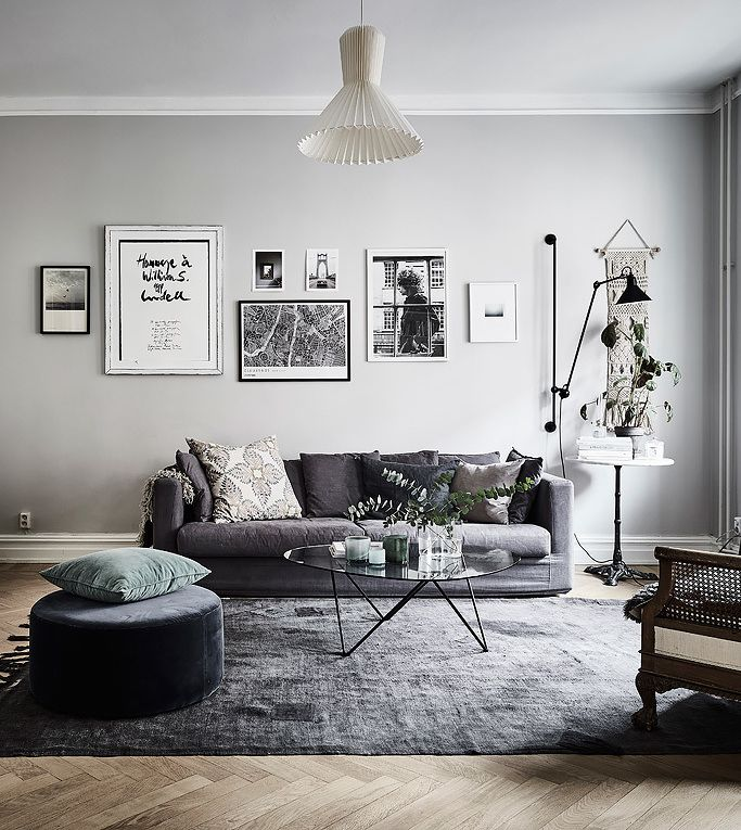 Grey wall with dark couch