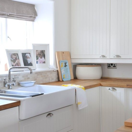 White Shaker-style kitchen with butler sink