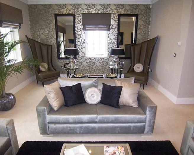 Photo of designer grey silver metallic living room lounge with pattern wallpaper and chairs - Silver living room designs ...