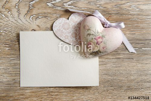 Love concept with shabby chic hearts and blank paper for message on wooden texture. Wedding or valentine's day background  with copy space