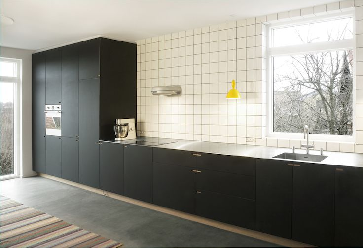 Minimalistic Oakwood kitchen designed, built and installed by NicolajBo as part of a general renovation of a villa overlooking Utterslev Mose in Copenhagen.