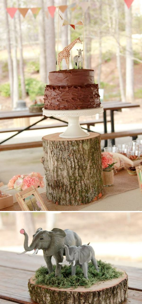 Use a tree stump for a rustic animal baby shower via Kara's Party Ideas @HUGGIES Baby Shower Planner Baby Shower Planner