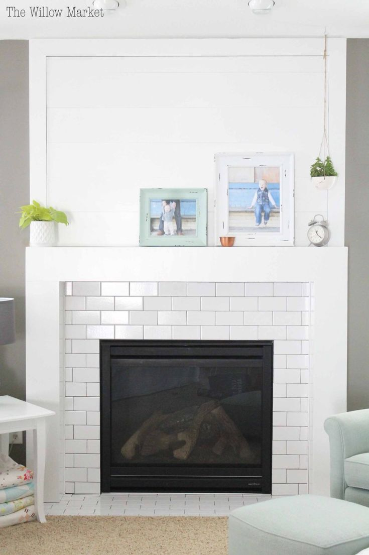 A New Fireplace With Shiplap And White Subway Tile Tile Around