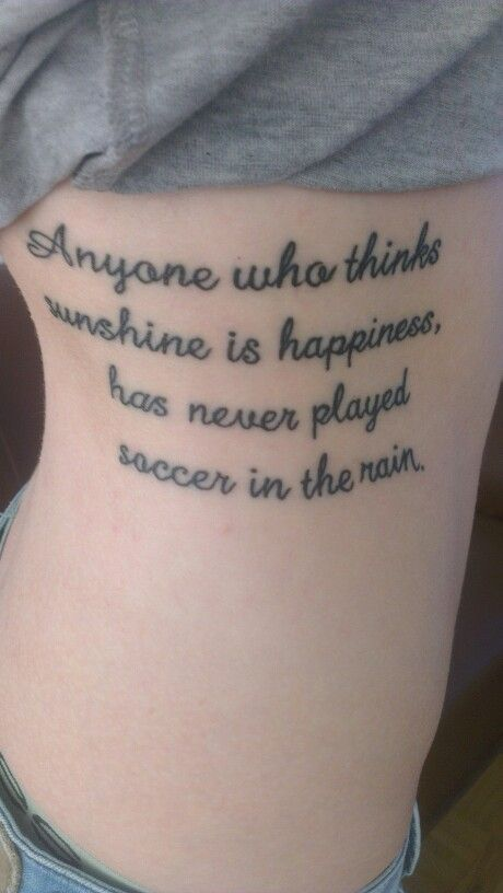 "Soccer tattoo ""Anyone who thinks sunshine is happiness, has never played soccer in the rain""."