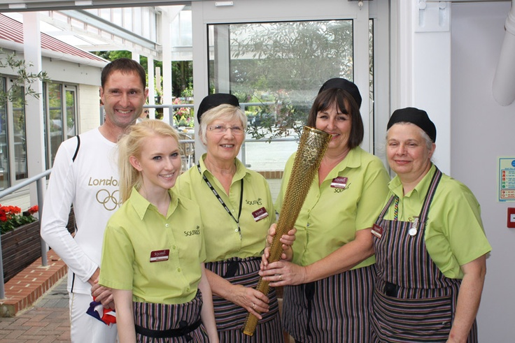 Staff at Seasons Restaurant in Badshot Lea getting their hands on the the Olympic flame.