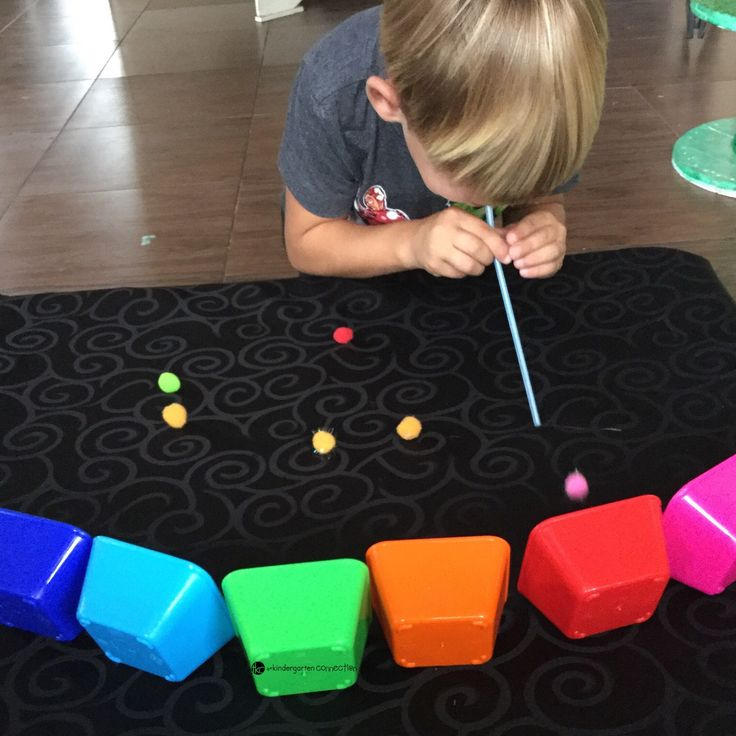 Rainbow Pompom race! A fun hands on matching colors game for preschoolers!