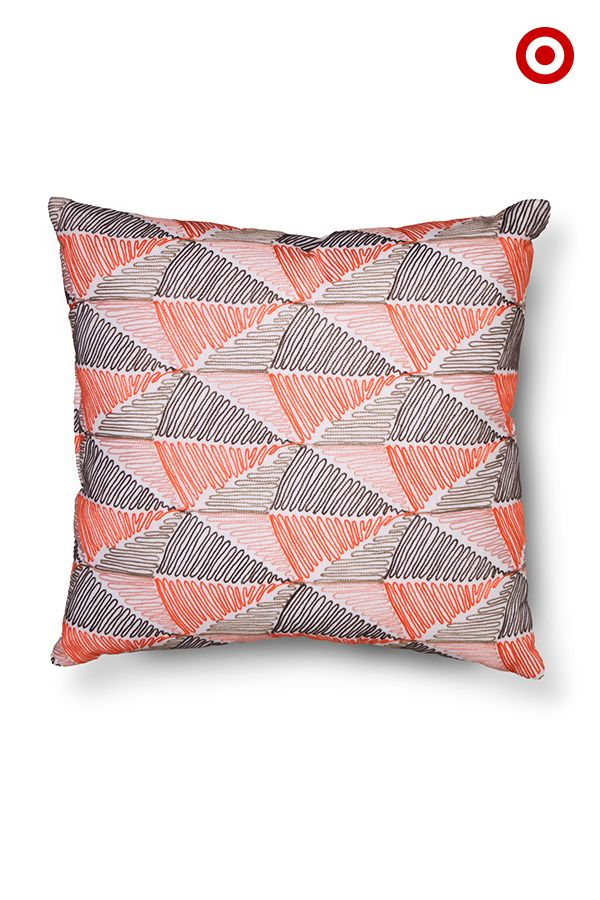 Thinking about a bedroom or living room refresh? This bright embroidered throw pillow will
