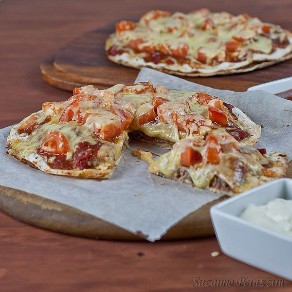 Mexican Tortilla Stacks - Tortillas layered with refried beans, mince meat, enchilada sauce, tomatoes and cheese.