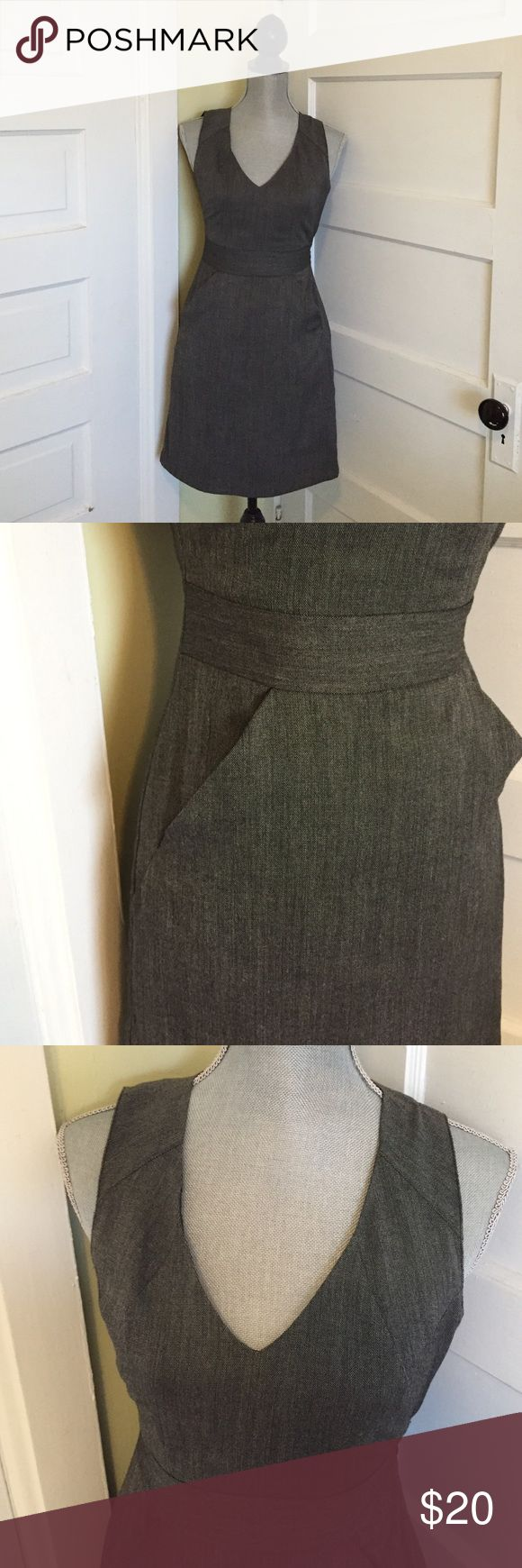 Fitted Grey Dress with Pockets! Charcoal grey dress with pockets and v-neck. The length is office appropriate and the straps are wide enough to hide bra straps. Side zip. Gap Dresses