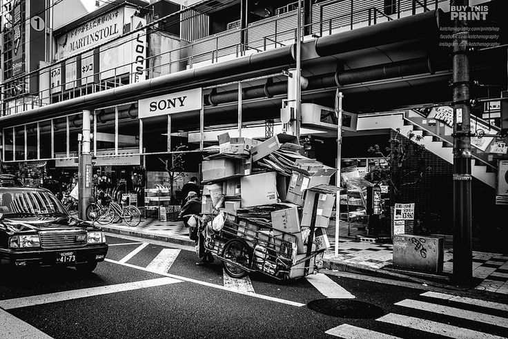 Osaka Streets - The streets of Dotonbori. This guy must be building a pretty big box fort..
