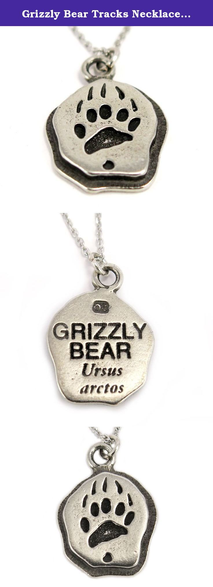 Grizzly Bear Tracks Necklace, Stainless Steel Chain. The pendant has a smooth finish to it with strong contrast. The grizzly bear tracks has a unique shape like no other animal. The grizzly bear is a symbol of power, physical strength, and integration.