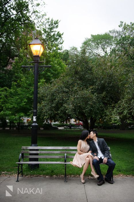 Chicago Wedding Photographer: Nakai Photography. Fun Cute Chicago engagement in a park- kissing on a bench next to lamp post! Asian (Korean) couple -Want to see more from this engagement session? http://www.nakaiphotography.com/engagement-photos/chicago-urban-night-carnival-lyric-opera-bridge-hyejin-jon/