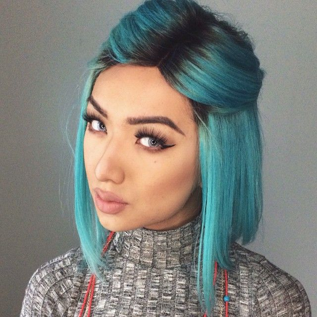 blue hair, winged liner and a pale rose lip. cute hairstyle half up and half down, easy simple