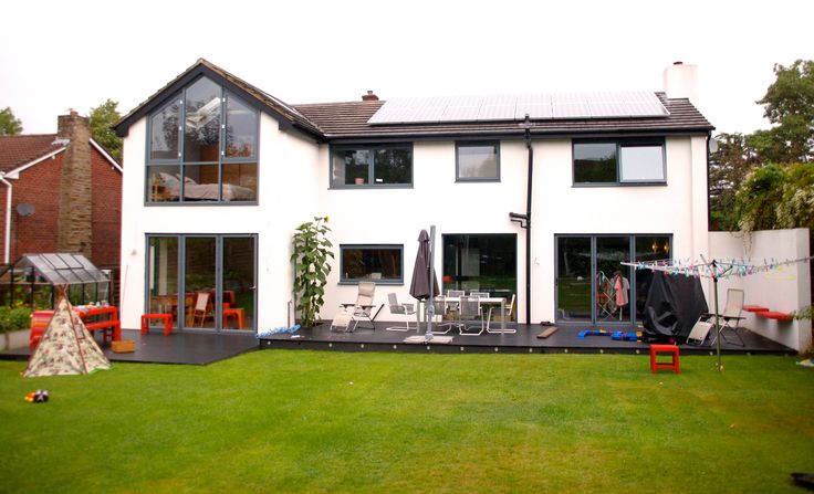 Finished Build - aluminium windows and bi fold doors give house new lease of life with thermal rendering replacing cladded single skin walls