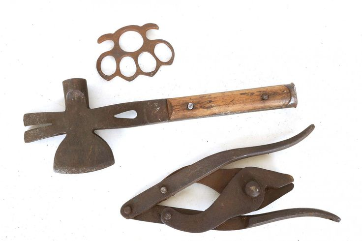 A WWII snail brand French multi tool, wire cutters and a pair of knuckle dusters.