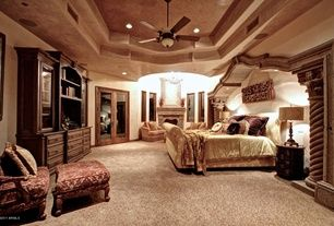 Mediterranean Master Bedroom with High ceiling, stone fireplace, Columns, French doors, Chandelier, Upholstered sleigh bed