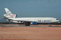 Air Liberté (BA) (FR) (ceased ops 2003) McDonnell Douglas DC-10-30 F-GPVA aircraft, with ''L'esprit Liberte'' Celebrating human rights movement motif on tail fin, skating at Portugal Faro International Aireport. November 2001.