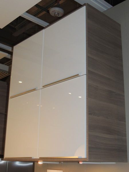 we love the glossy white cabinet doors against the contrasting framing from the ikea showroom