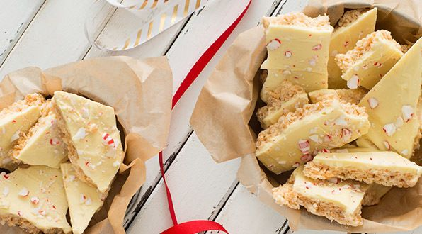 These Rice Krispies* treats are transformed into delicious holiday bark with a layer of white chocolate and crushed candy canes. It's a quick and easy sweet to add to your holiday baking.