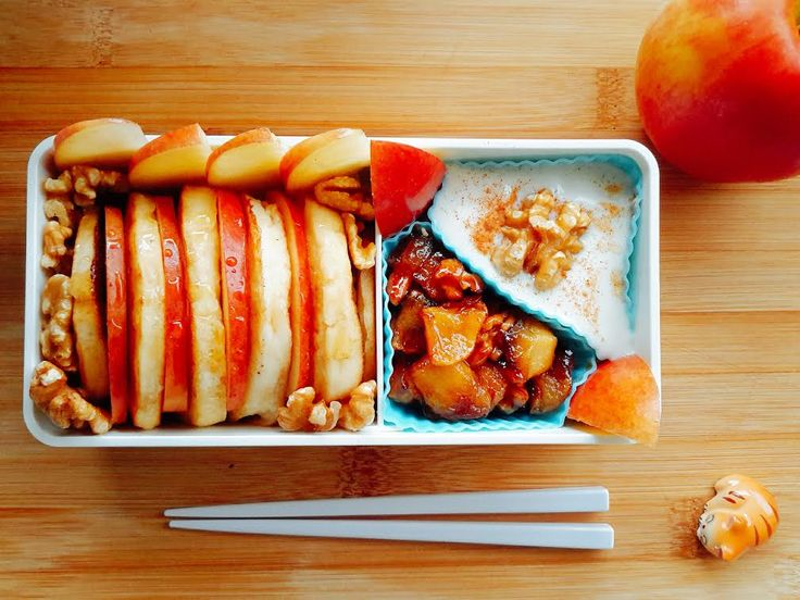 #100 Rebecca Australia It is Autumn in Australia so I wanted to make a bento with Autumn tastes such as apples, cinnamon and walnuts. This is a breakfast bento of pancakes with vanilla yoghurt, apple compote and maple syrup with plenty of fresh apple slices and walnuts to snack on.