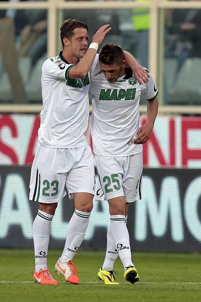 Domenico Berardi (L) and  Marcello Gazzola of US Sassuolo Calcio celebrates after scoring a gol during the Serie A match between ACF Fiorent...