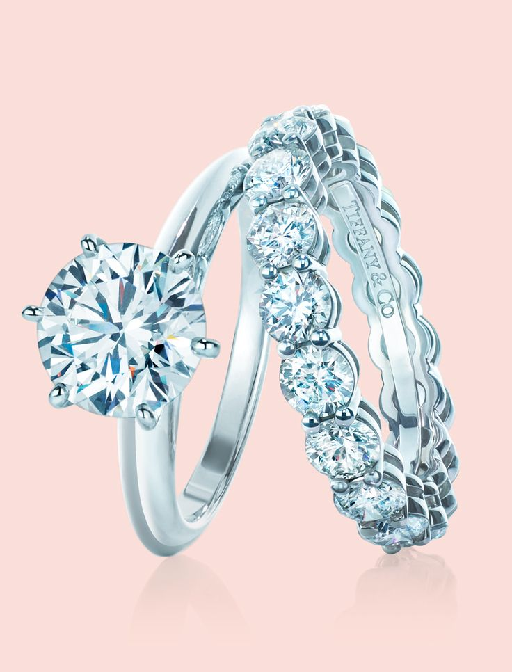 A Tiffany love story. The Tiffany® Setting engagement ring with a shared-setting band ring in platinum with diamonds.